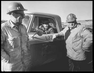 Ed Poor, Superintendent; Warren Mattielli, Production Foreman; and Joe Usibelli, President of Usibelli Coal Mine